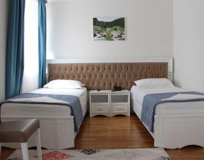 Doppelzimmer mit einzelbett